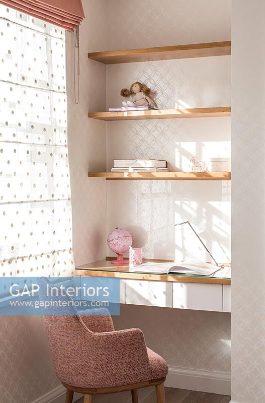 Shelves over desk and chair in childrens room