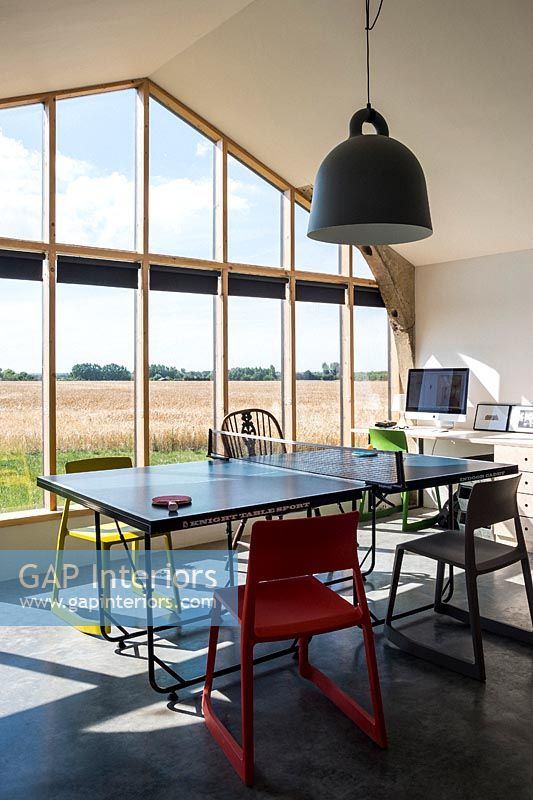 Modern dining room with glazed wall and views of countryside