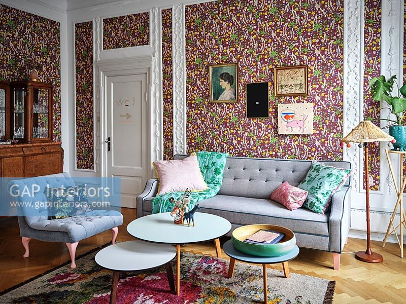 Colourful floral wallpaper in modern living room