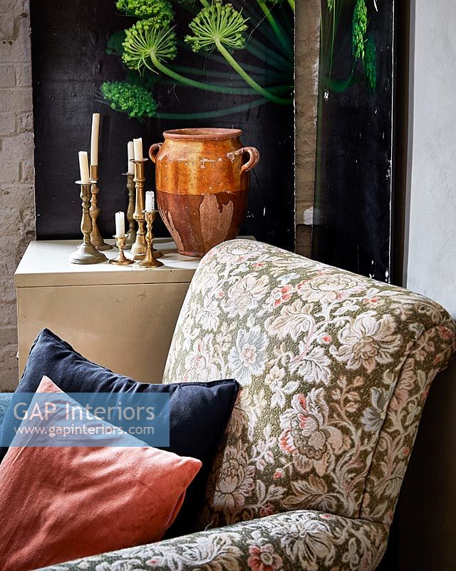 Floral armchair in corner of country living room
