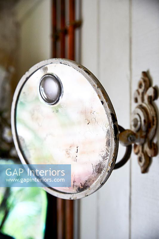 Wall mounted vintage magnifying mirror