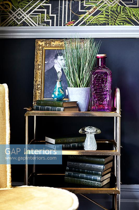 Gold trolley as side table in eclectic living room