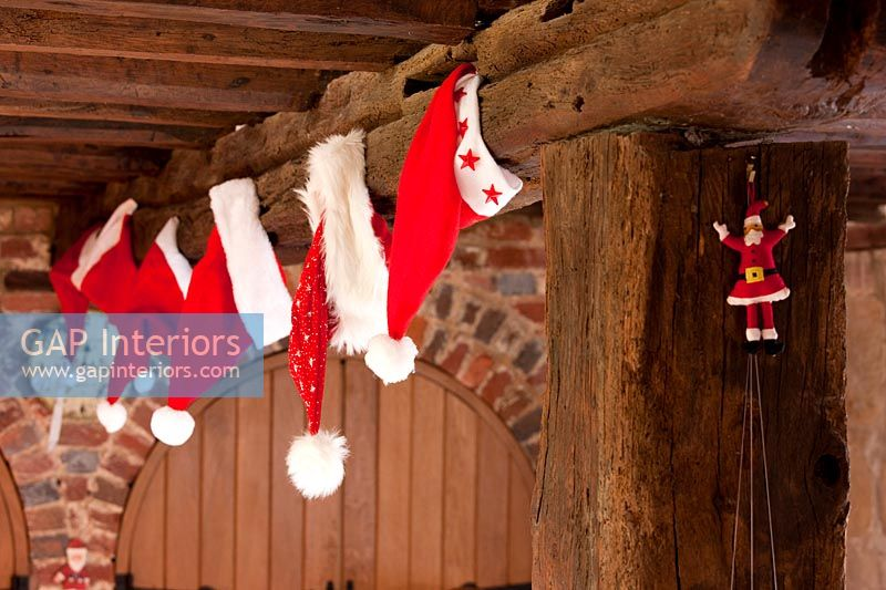 Christmas decorating hanging from wood beam