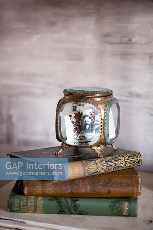 Ornate trinket box and books