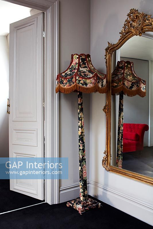 Ornate floor lamp and mirror
