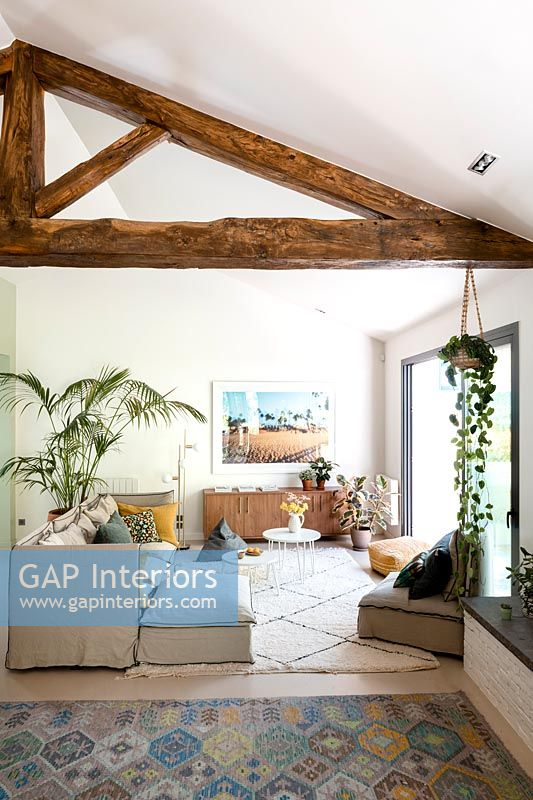 Modern living room with exposed wooden beams