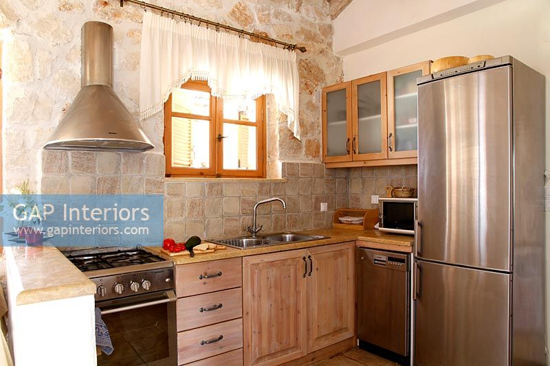 Country kitchen with exposed stone wall