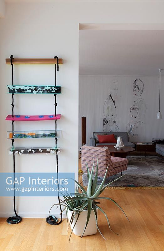 Decorative rope ladder on wall of modern living room