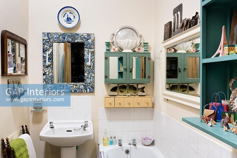 Small bathroom with mirrors on every wall