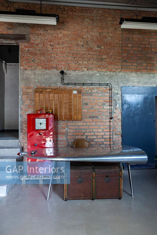 Vintage metal desk and chair in modern industrial study