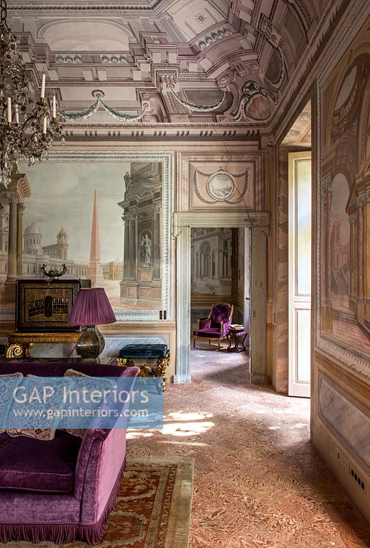 Classic living room with frescoes on walls and ceiling