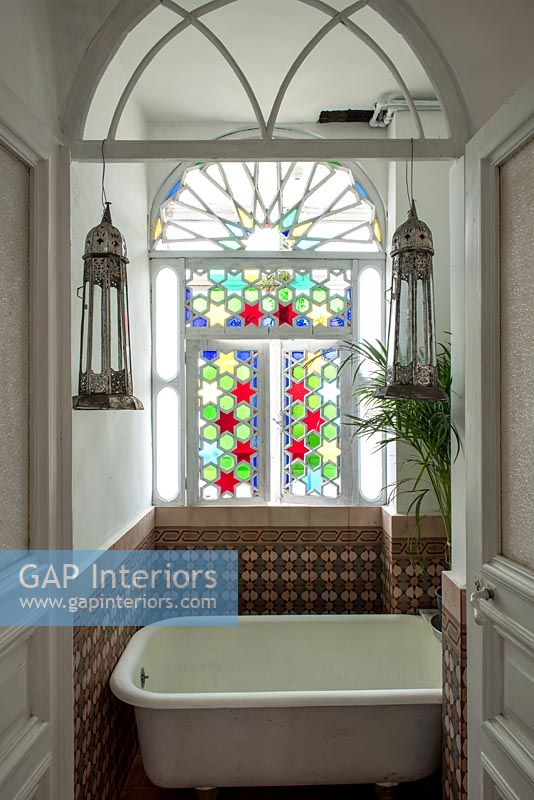 Colourful stained glass windows in classic style bathroom