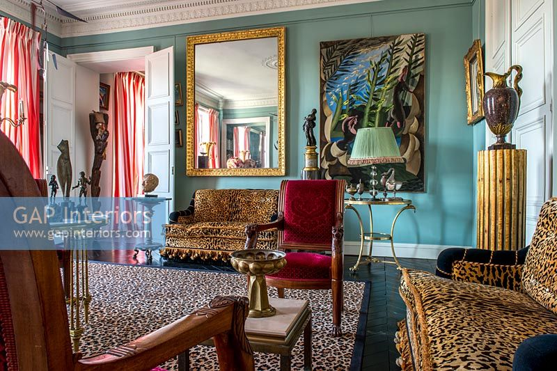 Colourfully eclectic living room with period features