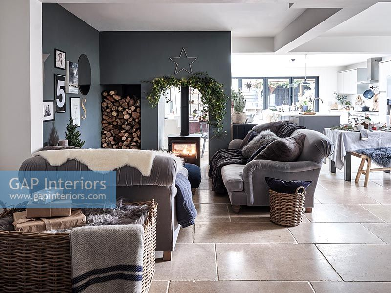 Open plan living space with central wood burner