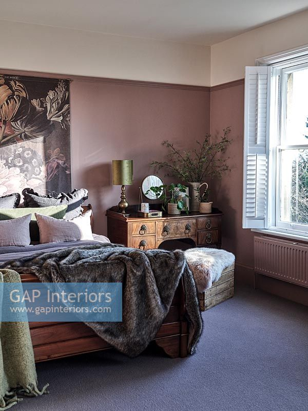 Modern country bedroom with dusky pink painted walls