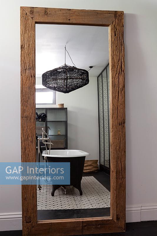 Reflection of modern bathroom in large mirror
