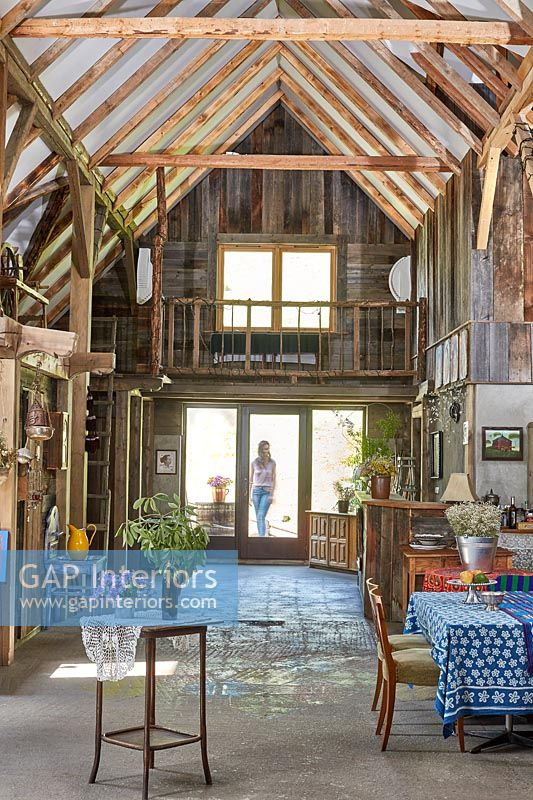 Woman standing outside converted barn