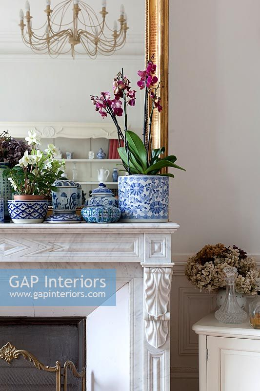 Blue and white ceramic pots on mantelpiece
