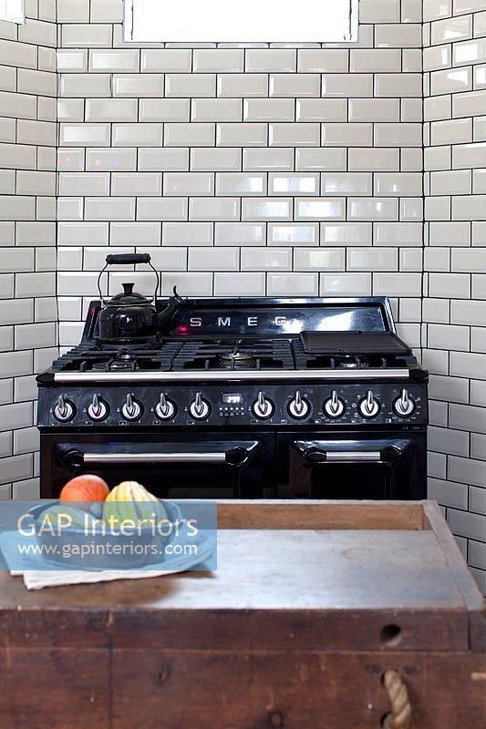 Large range cooker in modern kitchen