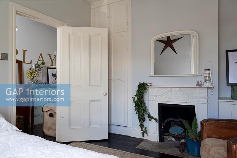 Bedroom door with mantelpiece and mirror