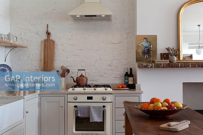 Cooker and extractor fan in simple white kitchen
