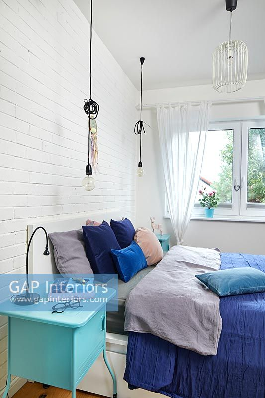 Modern bedroom in different shades of blue