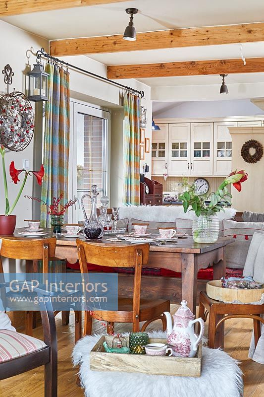 Open plan country living space decorated for Christmas