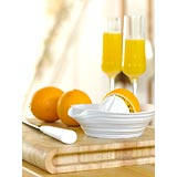 Oranges being squeezed for juice 