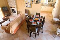 Corfu, Greece. Malama House near Barbati. Open plan Living and dining room with table and chairs set for dining. Water melons on table