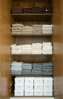 Tidy wardrobe showing sweaters from Tania Laurie latest collection