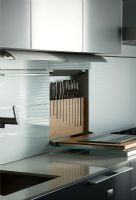 Contemporary kitchen with concealed pull down knife block