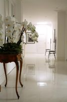 Classic white hallway wit console table and marble floor
