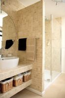 Modern bathroom with large tiled shower enclosure