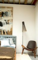 Contemporary bedroom with Seppo Koho Lamp and shell chair