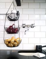 Detail of storage baskets hanging in kitchen