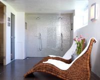 Contemporary bathroom with double shower and seating area