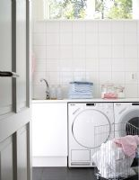 Modern kitchen with washing machine and tumble dryer