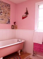 Pink bathroom with freestanding bath