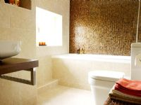 View to modern bathroom with mosaic tiled feature wall