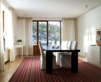 Modern dining room with stripy rug
