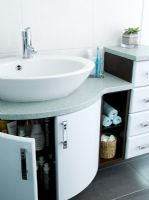 Modern bathroom with vanity unit and storage