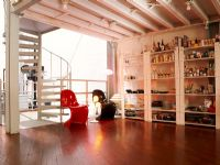 Spacious modern room with stocked shelves of alcohol