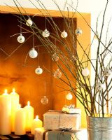 Modern Christmas decorations and lit candles