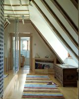 Loft with striped rug on laminate flooring