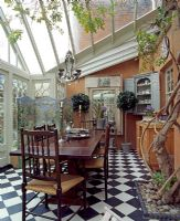 Wooden dining table and chairs in conservatory