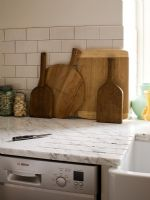 Wooden chopping boards on marble worktop