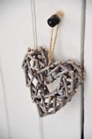 Wooden heart hanging on door handle