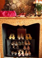 Shoes stored in fireplace