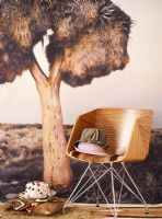 Wooden chair in front of a large wall photo