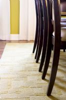 Chair Legs on Rug in Dining Room